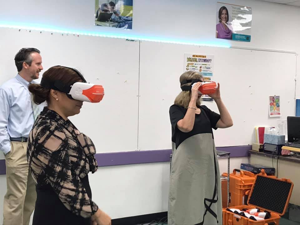 Teachers using VR headsets