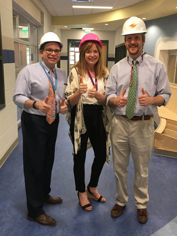Dr. Anderson with Dr. Fernandes and Mrs. August! Double Thumbs Up!